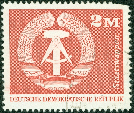 DDR- CIRCA 1975  A stamp printed in DDR shows Emblem of the DDR, circa 1975 Stock Photo - 13975796
