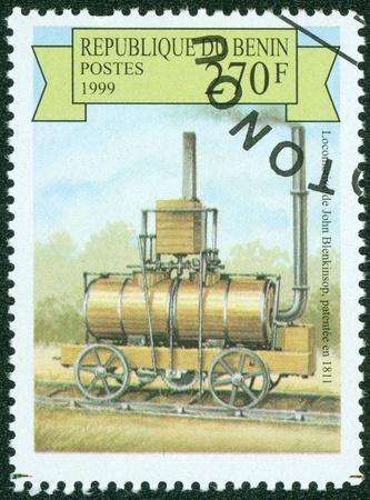BENIN- CIRCA 1999  A stamp printed in BENIN shows a locomotive, circa 1999