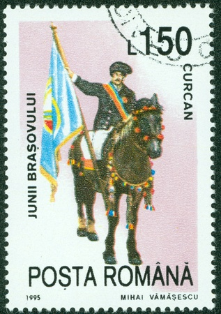 ROMANIA - CIRCA 1995  A stamp printed in the Romania showing celebrating man riding horse, circa 1995 photo