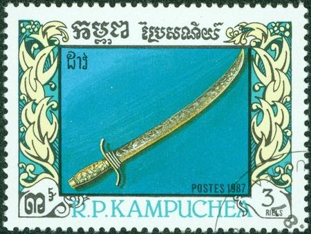 treasured: CAMBODIA - CIRCA 1987  A stamp printed in Cambodia, shows a sword, circa 1987