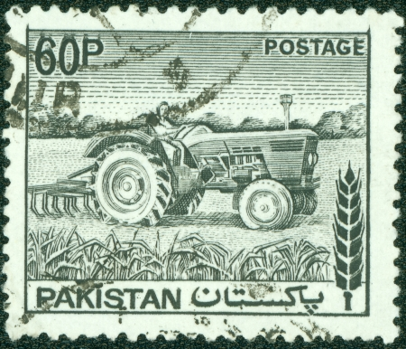 PAKISTAN - CIRCA 1970  A stamp printed in Pakistan shows woman tractor driver , circa 1970 photo