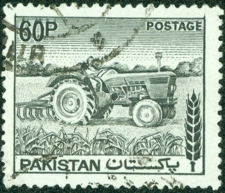 PAKISTAN - CIRCA 1970  A stamp printed in Pakistan shows woman tractor driver , circa 1970 Stock Photo - 14053871
