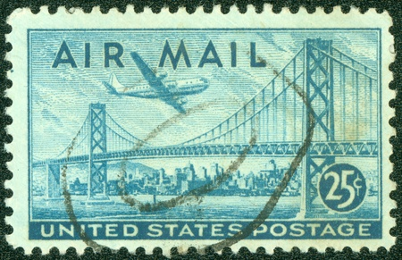 UNITED STATES OF AMERICA - CIRCA 1947  a stamp printed in the United States of America shows plane over San Francisco Oakland Bay Bridge, circa 1947