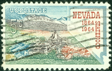statehood: USA - CIRCA 1964  A stamp printed in the USA shows Nevada statehood, 1864-1964, circa 1964 Stock Photo