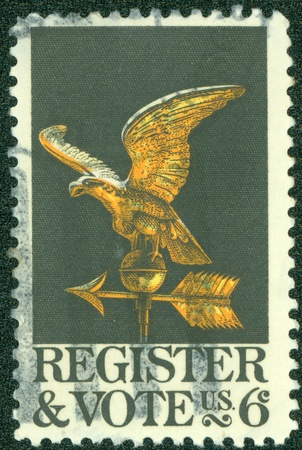 democracies: USA - CIRCA 1980  A stamp printed in the USA dedicated to the Voter registration is the requirement in some democracies for citizens, circa 1980  Stock Photo