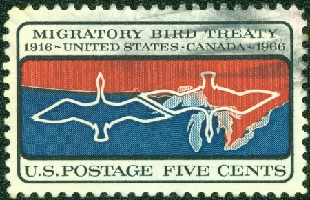 UNITED STATES OF AMERICA - CIRCA 1966  A stamp printed in the United States of America shows Migratory birds over Canada U S  border, circa 1966 photo