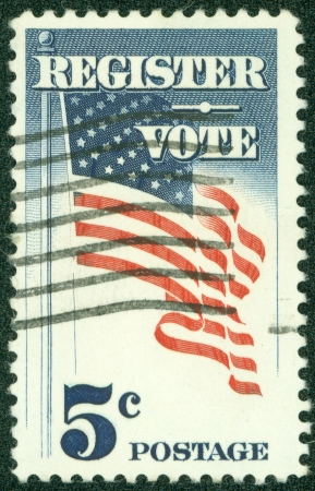 USA - CIRCA 1964  A Stamp printed in USA shows the U S  Flag, with the inscription  Register Vote , circa 1964 photo