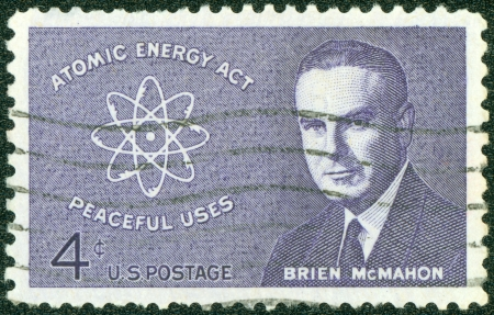 senator: UNITED STATES - CIRCA 1962  stamp printed by United states, shows Senator Brien McMahon and Atomic Diagram, circa 1962
