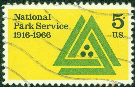 united states postal service: UNITED STATES - CIRCA 1966  stamp printed in USA shows National Park Service Emblem, 50th anniversary of the National Park Service of the Interior Department, the design Parkscape U S A , circa 1966