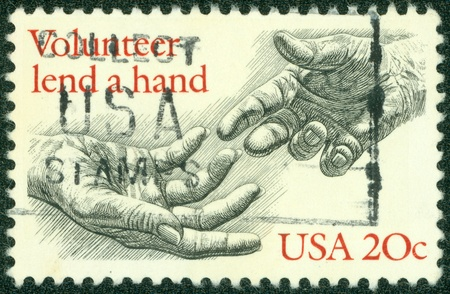 lend a hand: USA - CIRCA 1983  A stamp printed in USA shows the Human Hands, with the description  Volunteer lend a hand , circa 1983 Editorial