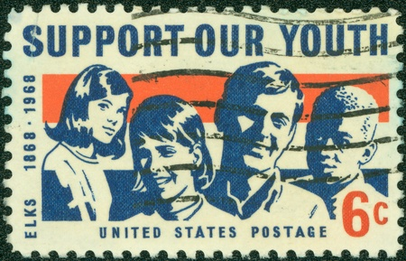 united states postal service: USA - CIRCA 1969  A stamp printed in USA shows a picture of young men and women with the words of Support Our Youth, circa 1969