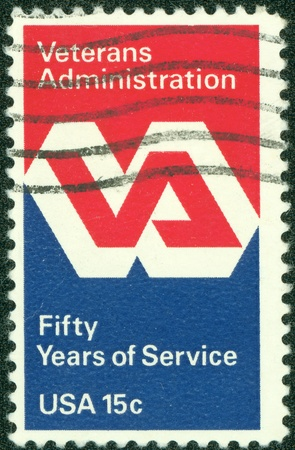 united states postal service: UNITED STATES OF AMERICA - CIRCA 1980  a stamp printed in the United States of America shows Veterans Administration Emblem, 50th anniversary of Service, circa 1980 Editorial