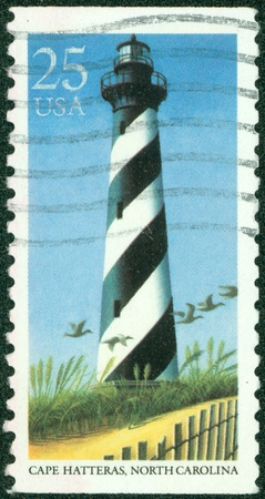 united states postal service: UNITED STATES OF AMERICA - CIRCA 1990  A stamp printed in the USA shows image of Cape Hatteras in North Carolina, circa 1990 Editorial