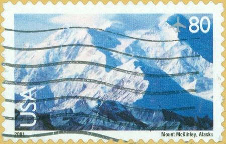 mckinley: UNITED STATES OF AMERICA - CIRCA 2001  A stamp printed in the United States of America shows image of Mount McKinley in Alaska, circa 2001 Editorial