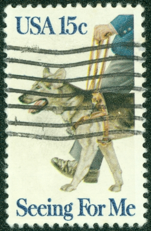 UNITED STATES OF AMERICA - CIRCA 1979   A stamp printed in the USA shows guide dog, Seeing for me, circa 1979 Stock Photo - 14242601