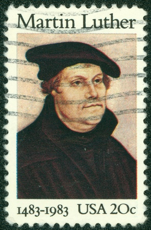 reformation: UNITED STATES OF AMERICA - CIRCA 1983  A stamp printed in USA shows image portrait Martin Luther was a German priest and professor of theology who initiated the Protestant Reformation, circa 1983