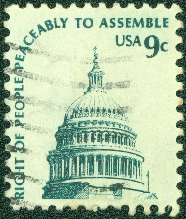 peaceably: UNITED STATES - CIRCA 1970 s   A stamp printed in United States  shows the dome of the United States Capitol with the text  The right of peaceful assemble , circa 1970 s
