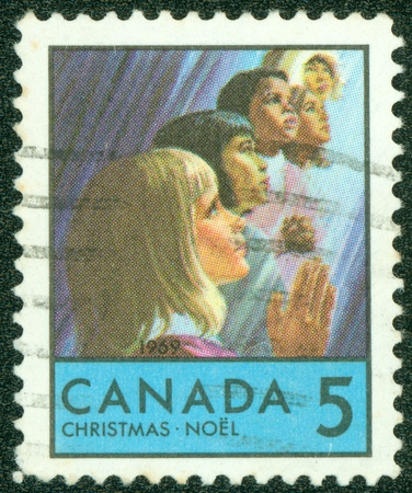 CANADA - CIRCA 1969  A greeting Christmas stamp printed by Canada, shows Children, circa 1969 photo