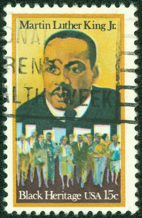 marchers: USA - CIRCA - 1979  A stamp printed in the United States of America shows Martin Luther King Jr  And civil rights marchers, Black heritage, circa 1979