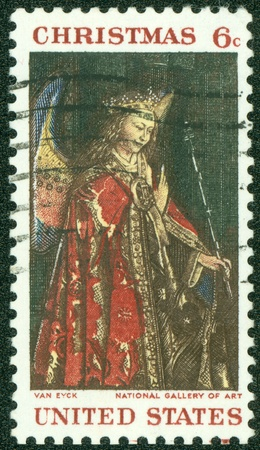 angel gabriel: UNITED STATES - CIRCA 1968  A stamp printed by United States of America, shows angel Gabriel from van Eyck Annunciation, circa 1968 Stock Photo