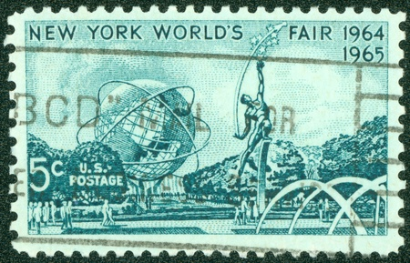 UNITED STATES OF AMERICA - CIRCA 1964  a stamp printed in the United States of America shows Mall with Unisphere and rocket thrower, by Donald De Lue from New York World s fair 1964, circa 1964 photo