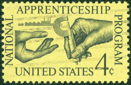 UNITED STATES - CIRCA 1962  A stamp printed in the United States, shows the Machinist Handing Micrometer to Apprentice, circa 1962 photo