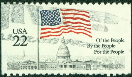 USA - CIRCA 1985  A stamp printed in the USA, shows a Flag over Capitol Dome, circa 1985 photo