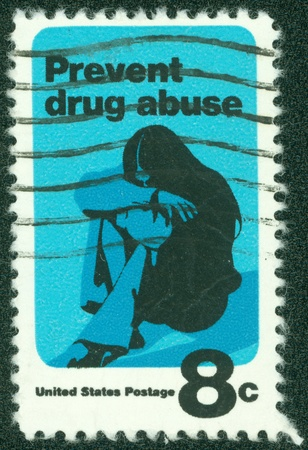 narcotism: USA - CIRCA 1971  A stamp printed in USA shows a Young Woman Drug Addict, Prevent Drug Abuse, Drug Abuse Prevention Week, circa 1971 Stock Photo