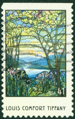 UNITED STATES OF AMERICA - CIRCA 2001  A stamp printed in USA shows Magnolia and Irises by Louis Comfort Tiffany, circa 2001