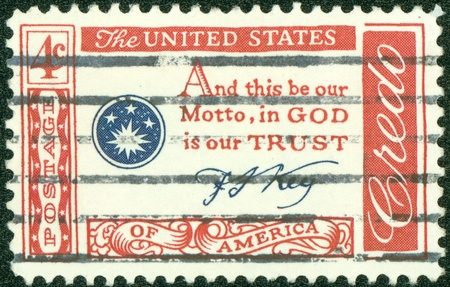 in god we trust: USA - CIRCA 1960   A stamp printed in the USA shows Credo, and this be our Motto, in GOD is our TRUST, circa 1960 Stock Photo