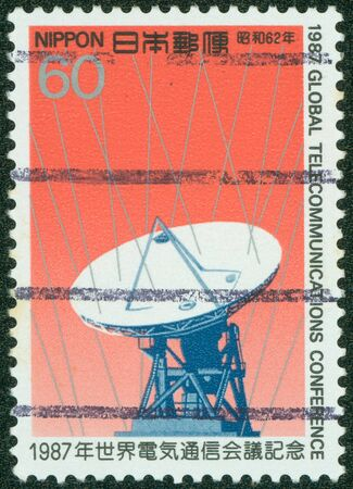 bundespost: JAPAN - CIRCA 1987  A stamp printed in Japan from the  Industry and Technology  issue showing a telecommunications dish, circa 1987  Stock Photo