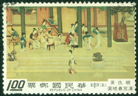 chinese postage stamp: TAIWAN - CIRCA 1980  A stamp printed in Taiwan shows a traditional painting of  Spring Morning in the Han Palace by Ch iu Ying, a famous artist during Ming Dynasty, circa 1980 Stock Photo