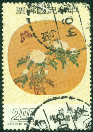 TAIWAN - CIRCA 1975  A stamp printed in Taiwan shows a traditional Chinese painting of butterfly and a flower  It is done by Ma Kue, a famous Chinese artist during Song Dynasty, circa 1975 photo