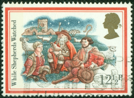 UNITED KINGDOM - CIRCA 1982  A British used Christmas postage stamp showing the Christmas Carol while Shepherds watched, circa 1982  photo