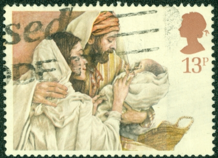 UNITED KINGDOM - CIRCA 1984  A stamp printed in United Kingdom shows a Christmas postage stamp with Mary, Joseph and Baby Jesus, circa 1984 photo