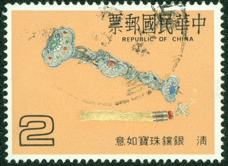 REPUBLIC OF CHINA  TAIWAN  - CIRCA 1986  A stamp printed in the Taiwan shows the ju-i of qing Dynasty, circa 1986 photo