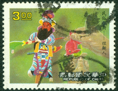 REPUBLIC OF CHINA  TAIWAN  - CIRCA 1995  A stamp printed in Taiwan shows chinese folk art art work made from powder , circa 1995