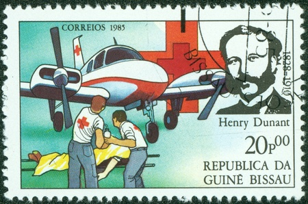 GUINEA BISSAU - CIRCA 1985  A stamp printed in Guinea Bissau shows Henry Dunant, founder of the Red Cross charity, circa 1985 Stock Photo - 14520960