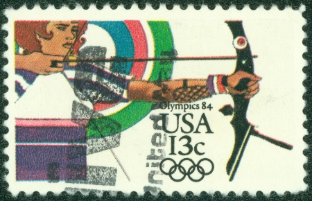 olympics: UNITED STATES - CIRCA 1984  depicting an archer and target, inscripted  Olympics 84  , face value 13 cents, circa 1984