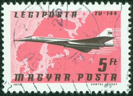 HUNGARY - CIRCA 1977  A stamp printed in Hungary from the  Planes, Airlines and Maps  issue shows a Tupolev TU-144, Aeroflot and Northern Europe map, circa 1977  photo