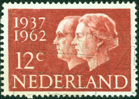 NETHERLANDS - CIRCA 1962  A stamp printed in the Netherlands, is dedicated to the 25th anniversary of the wedding, Queen Juliana and Prince Bernhard, circa 1962