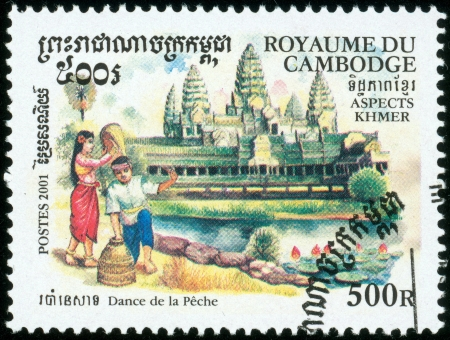 KAMPUCHEA-CIRCA 2001  A stamp printed in Cambodia, shows people with Angkor Wat, circa 2001 Editöryel