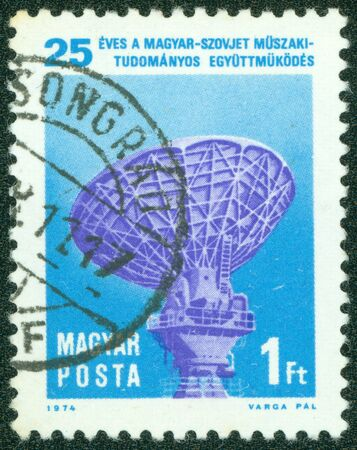 magyar posta: HUNGARY - CIRCA 1974  A stamp printed in Hungary honoring 25th Anniversary of Technical and Scientific Co-operation between Hungary and Soviet Union, shows Intersputnik Satellite Tracking Radar