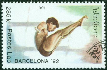 summer olympics: LAOS-CIRCA 1991  A stamp printed in the Laos, is devoted to the Summer Olympics in Barcelona, Diving, circa 1991