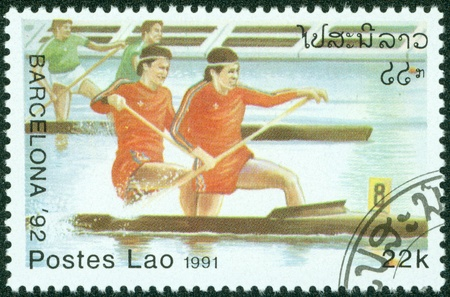 summer olympics: LAOS-CIRCA 1991  A stamp printed in the Laos, is devoted to the Summer Olympics in Barcelona, canoeing, circa 1991
