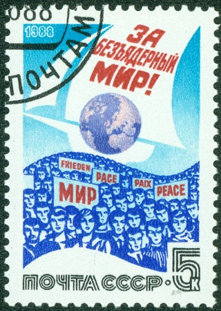 USSR - CIRCA 1988  A stamp printed in the USSR, devoted men, circa 1988 Stock Photo - 14660960