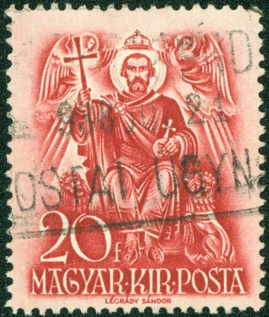 enthroned: HUNGARY - CIRCA 1937  A stamp printed by Hungary, shows Saint Stephen enthroned, circa 1937 Stock Photo