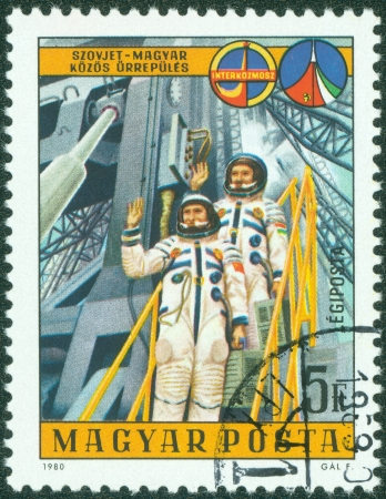 HUNGARY - CIRCA 1980  A stamp printed by Hungary, shows Two Cosmonauts and Launch Platform, circa 1980 photo