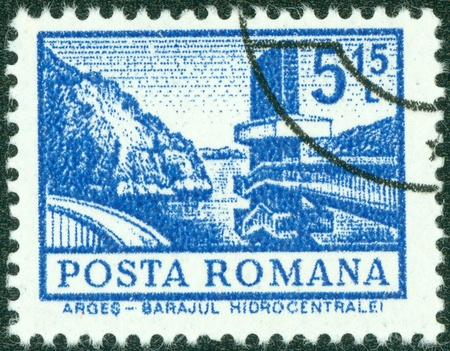 ROMANIA - CIRCA 1972  A stamp printed in Romania from the  Definitives I - Buildings  shows a Hydro-electric power station, Arges, circa 1972 Stock Photo - 14778286