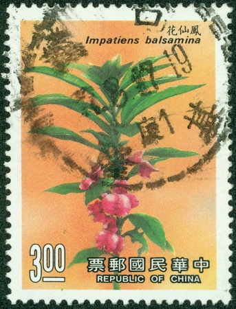 postmail: TAIWAN - CIRCA 2004  A post stamp printed in China shows impatiens flower , circa 2004